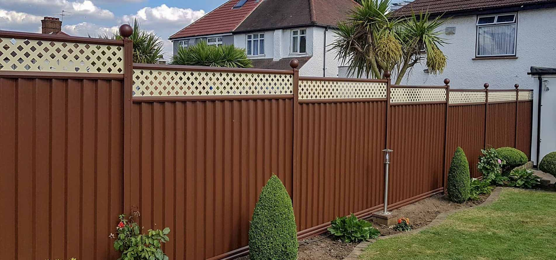 Metal garden fencing in March